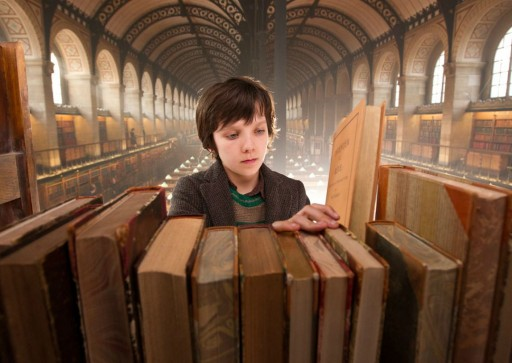 "Screencap from the movie ""Hugo"", showing Asa looking for a book in the library"