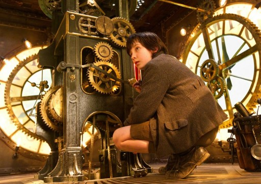 "Screencap from the movie ""Hugo"" showing the main character doing his job of winding the train station clocks"