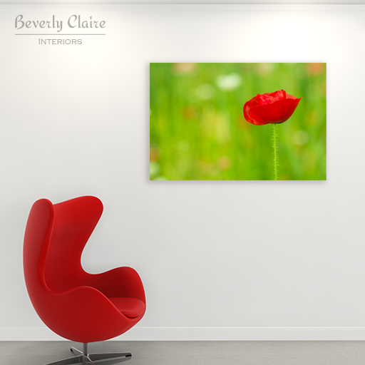 A very large canvas print of the poppy, next to the iconic Egg chair.