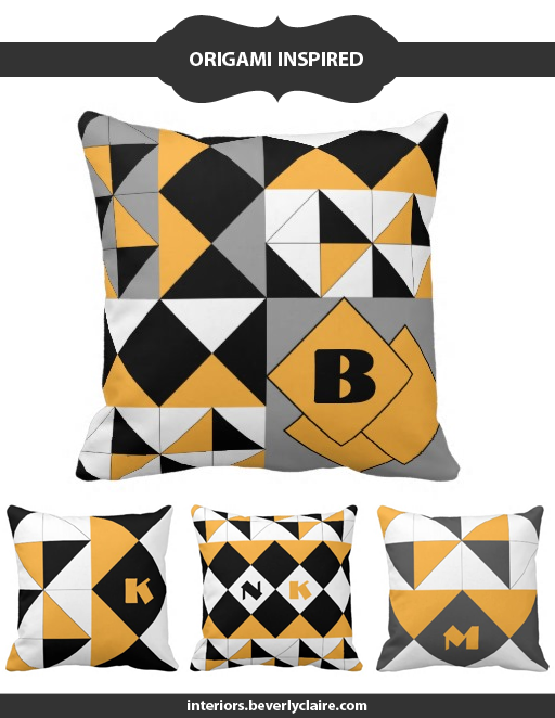 Origami-inspired pillow designs in black, white, grey and saffron yellow by Beverly Claire Interiors