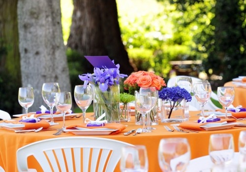 Purple and orange table setting designed by Elizabeth Anne Designs